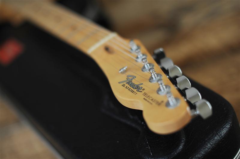 Telecaster headstock/ guitarist practicing tone
